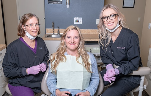One of our dentist sharing the Graham family difference with a female patient